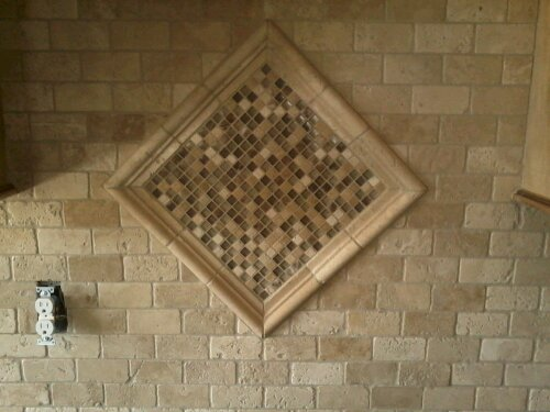 This was a beautiful custom tumbled stone backsplash that in a high end  home in Bowling Green.